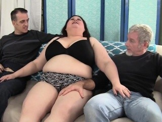 Brunette BBW Stazi sucks on two dudes' dicks and has her